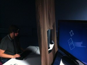 This experiment is designed to test orientation cues with stereo 3D (S3D) displays. The subject is sat behind a curtain with a square cut out of it, and can't see that the television is in fact twisted through an angle, and therefore not perpendicular. However because of the display being S3D the subject cannot distinguish this change in orientation and assumes that the screen is frontoparallel (perpendicular). This means that when we show the stimulus (in this experiment a pair of rotating cubes) the stimulus look warped unless they are projected for the angle the subject is sat at (orthostereo), in contrast to when the curtain is removed and the television can be seen to be rotated, at which point the subjects brain corrects for not being perpendicular and sees the orthostereo cube (rendered for the angle) as warped, and the perpendicular cube as correctly projected.